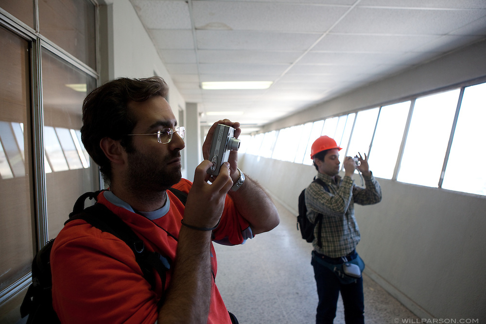 UCSD structural engineering grad students Gabriele Guerrini and Yannis Koutromanos take photos of damage inside the Mexicali federal building. A group of researchers led by Dr. Benson Shing, Vice Chair of the Department of Structural Engineering at the University of California, San Diego, inspected the earthquake damage in Mexicali, Mexico, April 7, 2010. A 7.2 magnitude earthquake in Baja California on Easter Sunday was felt as far away as Los Angeles.