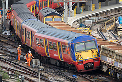 © Licensed to London News Pictures. 15/08/2017. London, UK. A derailed train rests on wagons of a freight train at Waterloo station in London after a low speed collision. People have been advised to avoid using Waterloo station, which is undergoing major development works, for the remainder of the day.  Photo credit: Peter Macdiarmid/LNP
