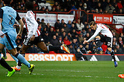 Brentford midfielder Konstantin Kerschbaumer (17) has a shot on goal during the EFL Sky Bet Championship match between Brentford and Rotherham United at Griffin Park, London, England on 25 February 2017. Photo by Andy Walter.