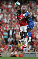 Photo: Lee Earle.<br /> Arsenal v Portsmouth. The FA Barclays Premiership. 02/09/2007.Arsenal's Emmanuel Adebayor (L) clashes with Noe Pamarot.
