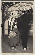 Kabuki actors showing feet of front actor in a horse costume (rear actor not visible), 1920s, silver gelatin bromide post card.<br />
