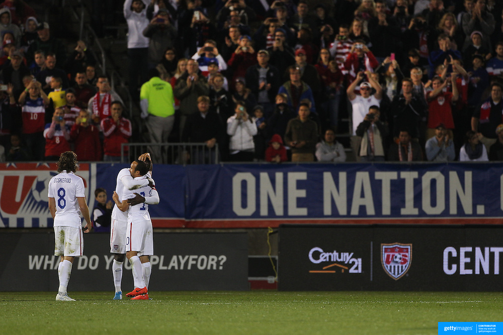 Landon Donovan, USA, is hugged by team mate Jozy Altidore after his substitution during his farewell match during the USA Vs Ecuador International match at Rentschler Field, Hartford, Connecticut. USA. 10th October 2014. Photo Tim Clayton