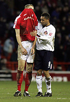 Fotball<br /> Championship England 2004/05<br /> Nottingham Forest v Sunderland<br /> 28. desember 2004<br /> Foto: Digitalsport<br /> NORWAY ONLY<br /> Nottingham's Michael Dawson pulls his jersey over his head as he is congratulated by Jeff Whitley at full time