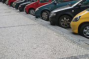 Cars parked along a pavement. Prague, Czech Republic, 2006