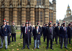 © Licensed to London News Pictures. 18/10/2012. Westminster, UK Members past and present from the 2nd Battalion of The Royal Regiment of Fusiliers march on Parliament today 18 October 2012 to hear a debate in the House on the future of their regiment. The regiment's existence is threatened by the governments plans to reduce the armed forces by 20,000 personel. Photo credit : Stephen Simpson/LNP