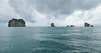 Limestone rock formations rising above the Andaman Sea Southern Thailand as a rain storm approaches&#xA;<br />