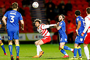 Doncaster Rovers forward Alex Kiwomya (23) is challenged by AFC Wimbledon defender Callum Kennedy (23)  during the EFL Sky Bet League 1 match between Doncaster Rovers and AFC Wimbledon at the Keepmoat Stadium, Doncaster, England on 1 May 2018. Picture by Simon Davies.