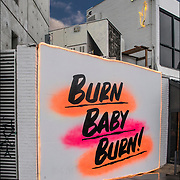 &quot;Sign Burn Baby Burn!&quot; replaced &quot;I Feel You Baby&quot; street art.<br /> <br /> Mural is next to Baby Brasa, a Peruvian restaurant for organic rotisserie chicken, sides, salads &amp; sandwiches on Seventh Avenue in Greenwich Village.