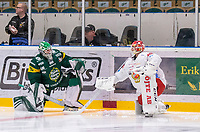 2019-12-14 | Umeå, Sweden:A small chat between the goalies before matchstart in HockeyAllsvenskan during the game  between Björklöven and Almtuna at A3 Arena ( Photo by: Michael Lundström | Swe Press Photo )<br /> <br /> Keywords: Umeå, Hockey, HockeyAllsvenskan, A3 Arena, Björklöven, Almtuna, mlba191214