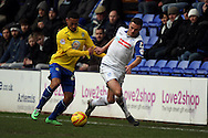Tranmere Rovers' Jason Koumas battles with Coventry City's Jordan Clarke. Skybet football league 1match, Tranmere Rovers v Coventry city at Prenton Park in Birkenhead, England on Saturday 22nd Feb 2014.<br /> pic by Chris Stading, Andrew Orchard sports photography.