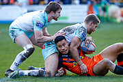 Castleford Tigers full back Ben Roberts (1) is tackled during the Betfred Super League match between Castleford Tigers and Widnes Vikings at the Jungle, Castleford, United Kingdom on 11 February 2018. Picture by Simon Davies.