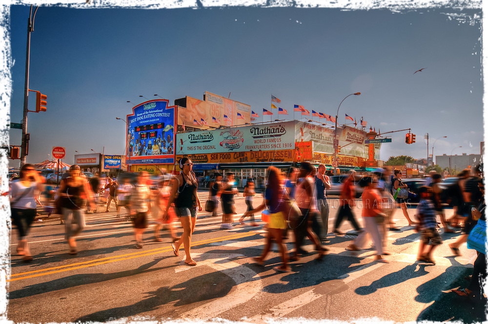 Coney Island is a peninsula and beach on the Atlantic Ocean in southern Brooklyn, New York, United States. The site was formerly an outer barrier island, but became partially connected to the mainland by landfill.<br /> <br /> Coney Island is possibly best known as the site of amusement parks and a major resort that reached their peak during the first half of the 20th century. It declined in popularity after World War II and endured years of neglect. In recent years, the area has seen the opening of MCU Park and has become home to the minor league baseball team the Brooklyn Cyclones.<br /> <br /> The neighborhood of the same name is a community of 60,000 people in the western part of the peninsula, with Sea Gate to its west, Brighton Beach and Manhattan Beach to its east, and Gravesend to the north.<br /> <br /> The Native American inhabitants of the region, the Lenape, called the island Narrioch--meaning &quot;land without shadows&quot;--because, as with other south shore Long Island beaches, its orientation means the beach remains in sunlight all day.<br /> <br /> Coney Island appears to be the English adaptation of the Dutch name Conyne Eylandt, or Konijneneiland in modern Dutch spelling. The word &quot;coney&quot; was popular in English at the time as an alternative for rabbit. Coney came into the English language through the Old French word conil, which itself derived from the Latin word for rabbit, cuniculus. As on other Long Island barrier islands, Coney Island had many and diverse rabbits, and rabbit hunting prospered until resort development eliminated their habitat. The Dutch name is found on the New Netherland map of 1639 by Johannes Vingboon, which is before any known English records.The English name &quot;Conney Isle&quot; appeared on maps as early as 1690, and by 1733 the modern name, Coney Island, was used.