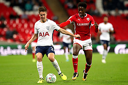 Barnsley's Ike Ugbo (right) and Tottenham Hotspur's Juan Foyth (left) battle for the ball during the Carabao Cup, third round match at Wembley Stadium, London.