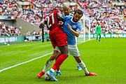 Manchester City midfielder Bernardo Silva (20) battles with Liverpool striker Divock Origi (27) during the FA Community Shield match between Manchester City and Liverpool at Wembley Stadium, London, England on 4 August 2019.