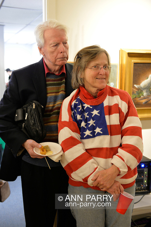 Huntington, New York, USA. February 20, 2014. THOMAS C. MCCARTHY and ALTHEA TRAVIS, wearing a patriotic red white and blue sweater with stars and stripes, attend The Jingle Boom Holiday Bash.