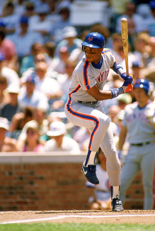CHICAGO - 1989: Darryl Strawberry of the New York Mets bats during an MLB game against the Chicago Cubs at Wrigley Field in Chicago, Illinois during the 1989 season. (Photo by Ron Vesely).  Subject:   Darryl Strawberry