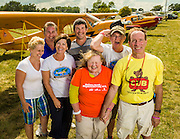 Piper Cub owners at Oshkosh, enjoying a moment of family fun during AirVenture 2012.  Oshkosh, Wisconsin.  <br />