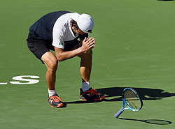 March 11, 2018 - Indian Wells, CA, U.S. - INDIAN WELLS, CA - MARCH 11: Taro Daniel (JPN) reacts after defeating the tenth seed Novak Djokovic (SRB) to advance to the next round of the BNP Paribas Open during a match played on March 11, 2018 at the Indian Wells Tennis Garden in Indian Wells, CA. (Photo by John Cordes/Icon Sportswire) (Credit Image: © John Cordes/Icon SMI via ZUMA Press)