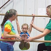 Rebecca Bishop, left and Michele Zapple, owners of Carolina Gymnastics Academy work with Jane Townend, 8 at the academy Tuesday January 21, 2014.  (Jason A. Frizzelle)
