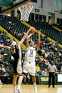 Raider junior Armond Battle (12) shoots for two in the second half as the Idaho Vandals play the Wright State University Raiders at the Nutter Center, Tuesday, December 20, 2011.