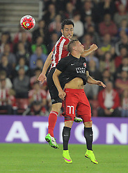 Maya Yoshida of Southampton and Daniel Royer of FC Midtjylland challenge for the ball - Mandatory byline: Paul Terry/JMP - 07966386802 - 20/08/2015 - FOOTBALL - ST Marys Stadium -Southampton,England - Southampton v FC Midtjylland - EUROPA League Play-Off Round