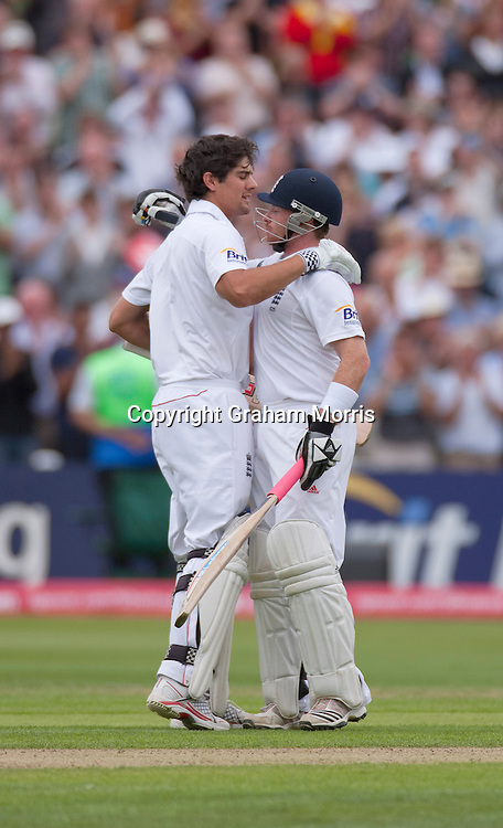 Ian Bell(right) congratulates Alastair Cook on his century in the third npower Test Match between England and India at Edgbaston, Birmingham.  Photo: Graham Morris (Tel: +44(0)20 8969 4192 Email: sales@cricketpix.com) 11/08/11