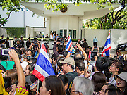 29 NOVEMBER 2013 - BANGKOK, THAILAND: Anti-government protestors in front of the US Embassy on Witthayu Road (also called Wireless Road) in Bangkok. Several thousand Thai anti-government protestors marched on the US Embassy in Bangkok. They blew whistles and asked the US to honor their efforts to unseat the elected government of Yingluck Shinawatra. The anti-government protestors marched through several parts of Bangkok Friday paralyzing traffic but no clashes were reported, even after a group protestors tried to occupy Army headquarters.       PHOTO BY JACK KURTZ