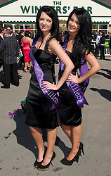 LIVERPOOL, ENGLAND, Thursday, April 7, 2011: Twins Jessica and Jemma during Ladies' Day on Day Two of the Aintree Grand National Festival at Aintree Racecourse. (Photo by David Rawcliffe/Propaganda)