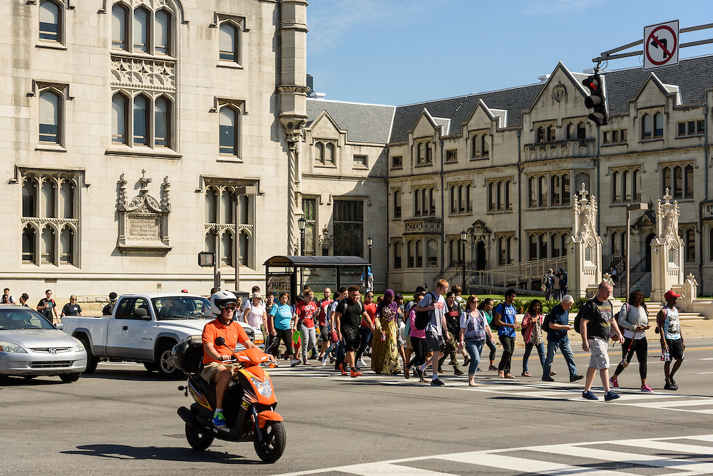 Students cross Broadway at First Street outside Seminary Hall on the Jefferson Community & Technical College downtown campus Thursday, Sept. 22, 2016 in Louisville, Ky. (Photo by Brian Bohannon)