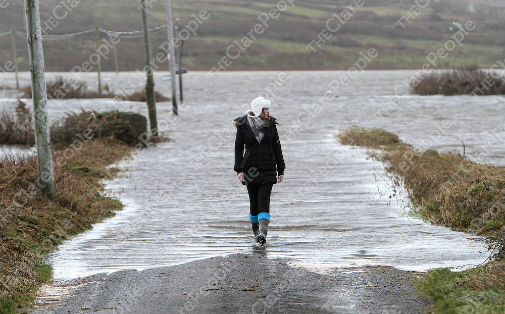 Jayne Gavin of Kilkee pictured in Kilcredaun near Carrigaholt where the road was completely coverd with water from the sea. Pictures of storm damage in the Loophead Peninsula Co. Clare. Pic Noel Gavin/Press 22