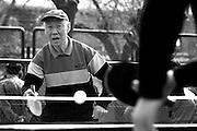 An elderly man plays table tennis in a Beijing public park.