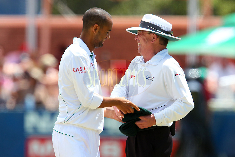 Robin Petersen shares a lighter moment with the umpire during the 3rd day of the 1st Sunfoil Test match between South Africa and New Zealand held at Newlands Stadium in Cape Town, South Africa on the 4th January 2013..Photo by Ron Gaunt/SPORTZPICS .