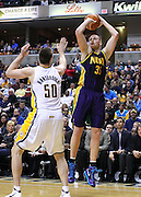 Feb. 21, 2012; Indianapolis, IN, USA; New Orleans Hornets center Chris Kaman (35) shoots the ball over Indiana Pacers power forward Tyler Hansbrough (50) at Bankers Life Fieldhouse. Indiana defeated New Orleans 117-108. Mandatory credit: Michael Hickey-US PRESSWIRE