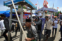 Decorations being carried away at the end of the Maulid Nabi festival. Cikoang, Sulawesi, Indonesia.