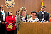 22 FEBRUARY 2011 - PHOENIX, AZ: County Supervisor Mary Rose Wilcox helps Ricardo Perez speak at the State Capitol in Phoenix Tuesday. Hundreds of people including supporters of immigrants' rights, supporters of border defense, motorcycle riders and members of the Tea Party, converged on the capitol to express their views on bills.  Perez spoke about his dream of becoming an architect and how legislation like that of Sen Russell Pearce threatened that dream.      PHOTO BY JACK KURTZ