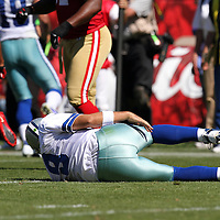 Dallas Cowboys quarterback Tony Romo (9) gets injured by San Francisco 49ers cornerback Carlos Rogers (22) during an NFL football game between the Dallas Cowboys and the San Francisco 49ers at Candlestick Park on Sunday, Sept. 18, 2011 in San Francisco, CA.   (Photo/Alex Menendez)