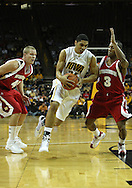 21 JANUARY 2009: Iowa's Aaron Fuller (24) drives to the basket between Wisconsin's Joe Krabbenhoft (45) and Trévon Hughes (3) during the first half of an NCAA college basketball game Wednesday, Jan. 21, 2009, at Carver-Hawkeye Arena in Iowa City, Iowa. Iowa defeated Wisconsin 73-69 in overtime.