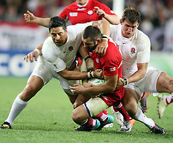 Georgia's Tedo Zibzibadze, centre, in the tackle of  England's Shontayne Hape, left, and Tom Wood in the Rugby World Cup pool match at Otago Stadium, Dunedin, New Zealand, Sunday, September 18, 2011. Credit:SNPA / Dianne Manson.
