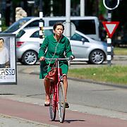 NLD/Amsterdam/20110511 - Zwangere PVDA politica Mei Li Vos op de fiets
