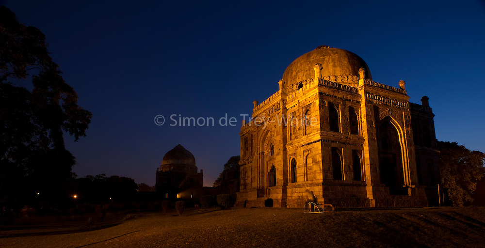 12th October 2011,New Delhi, India. The Sheesh Gumbad  (&quot;Glass dome&quot;) monument floodlit in the early evening in Lodi Gardens, New Delhi<br /> <br /> Lodi Gardens is a park in Delhi, India. Spread over 90 acres. It contains, Mohammed Shah's Tomb, Sikander Lodi's Tomb, Sheesh Gumbad and Bara Gumbad, architectural works of the 15th century Sayyid and Lodis, a Pashtun dynasty which ruled much of Northern India during the 16th century, and the site is now protected by the Archeological Survey of India (ASI).<br /> PHOTOGRAPH BY AND COPYRIGHT OF SIMON DE TREY-WHITE<br /> <br /> + 91 98103 99809<br /> + 91 11 435 06980<br /> +44 07966 405896<br /> +44 1963 220 745<br /> email: simon@simondetreywhite.com photographer in delhi