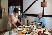 Rosemarie and Ralph Paladino sit down to dinner at their home in Utica, NY on September 3, 2015. The Paladinos live primarily on Ralph's police officer's pension and social security, and have home equity loan with an interest rate linked to the prime lending rate. A Fed rate increase would force their already tight budget even further. Photographer: Mike Bradley/Bloomberg