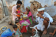 Ramratan is invited to stop and share tea and snacks by one of his clients.  The entire family joins him--in fact, over the past 40 years he has seen them grow and change and is indeed regarded as a close family member.