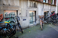 """A wall with the sign """"please park no bikes"""". The Hague, Netherlands"""