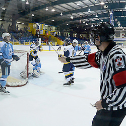 Whitby, ON - Feb - 9 :<br /> Ontario Junior Hockey League Game Action between the Whitby Fury and the Burlington Cougars. Linesman signals a goal during second period game action.<br /> (Photo by Scott Grondin / OJHL Images)