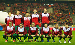BRUSSELS, BELGIUM - Tuesday, October 15, 2013: Wales' players line up for a team group photograph before the 2014 FIFA World Cup Brazil Qualifying Group A match against Belgium at the Koning Boudewijnstadion. Back row L-R: David Vaughan, Andy King, Neil Taylor, James Collins, goalkeeper Wayne Hennessey. Front row L-R: Hal Robson-Kanu, Chris Gunter, Simon Church, captain Aaron Ramsey, Ashley 'Jazz' Richards, Craig Bellamy. (Pic by David Rawcliffe/Propaganda)