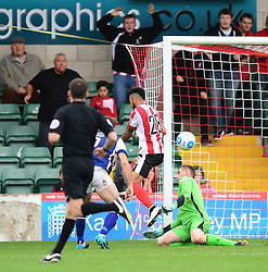 Barrow's Joel Dixon fails to prevent Lincoln City's Nathan Arnold scoring his sides equalising goal to make the score 1-1<br /> <br /> Picture: Chris Vaughan/Chris Vaughan Photography<br /> <br /> Football - Vanarama National League - Lincoln City Vs Barrow - Saturday 17th September 2016 - Sincil Bank - Lincoln<br /> <br /> Copyright © 2016 Chris Vaughan Photography. All rights reserved. Unit 11, Churchill Business Park, Bracebridge Heath, Lincoln, LN4 2FF - Telephone: 07764170783 - info@chrisvaughanphotography.co.uk - www.chrisvaughanphotography.co.uk