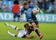 PRETORIA, South Africa, 14 May 2011. Bjorn Basson of the Bulls goes over for his try during the Super15 Rugby match between the Bulls and the Melbourne Rebels at Loftus Versfeld in Pretoria, South Africa on 14 May 2011..Photographer : Anton de Villiers / SPORTZPICS