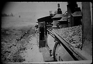 View down engineer's-side of rear helper engine, possibly on Lizard Head Pass, as seen from the caboose.  Appears to be a Baldwin C-16 by the fluted domes.<br /> RGS  Lizard Head Pass ?, CO  <br /> Thanks to Don Bergman for additional information.
