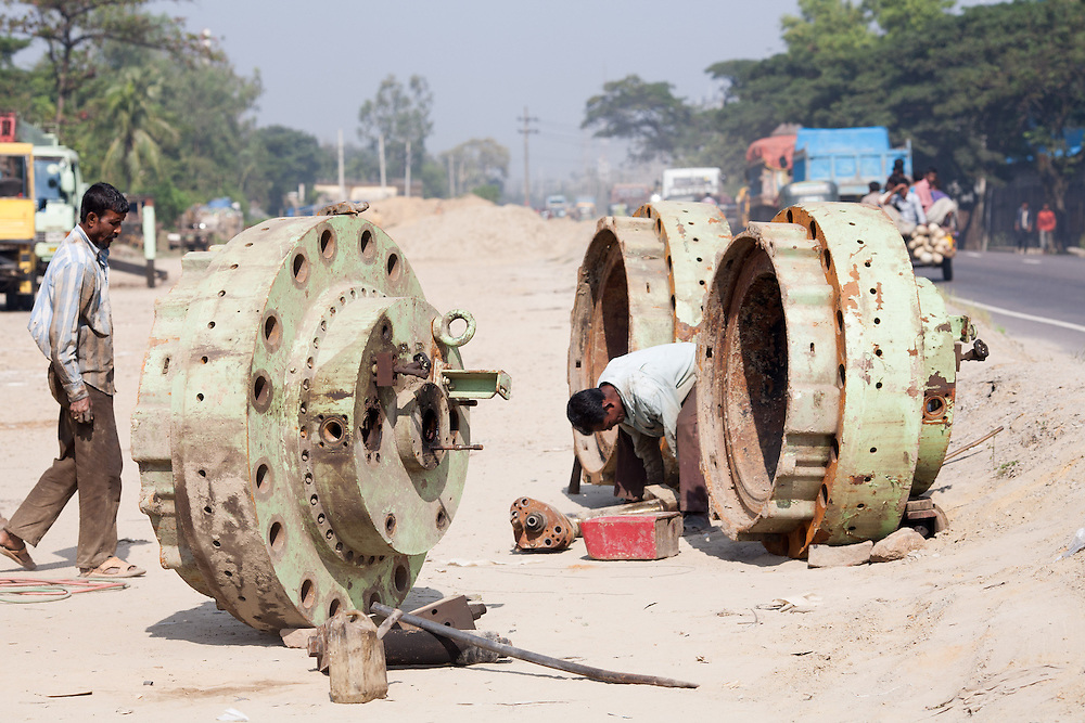 Parts of Machinery and equipment stripped from the infamous ship breaking yards in Sitakunda, south from Chittagong. the ships are stripped by manual labor in poor working conditions. The steel provides Bangladesh which much of the steel needed for domestic construction.
