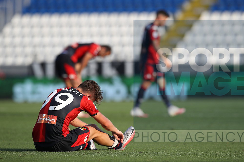 Genoa's Italian striker Andrea Pinamonti loosens his laces as his sits on the pitch following the final whistle of the Serie A match at Stadio Mario Rigamonti, Brecsia. Picture date: 27th June 2020. Picture credit should read: Jonathan Moscrop/Sportimage